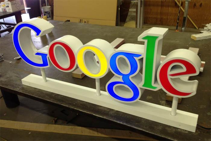 Custom channel letter set mounted on raceway LED illuminated Google logo