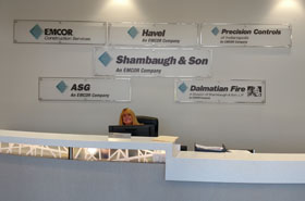 picture of reception desk signage for shaumbaugh and sons