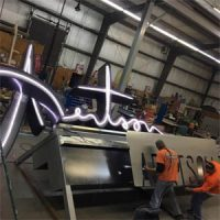 AutoZone pylon sign face install