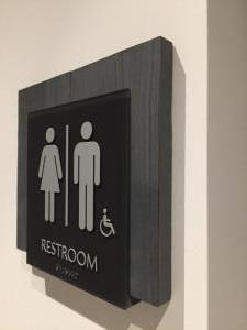 interior-restroom-sign-wood-backer-aertson