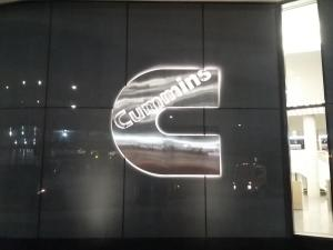 reverse-lit-stainless-steel-cummins-logo-spandrel-glass-install